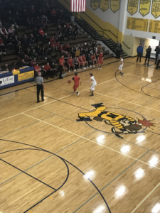 The Redmen look to score in their 67-36 defeat of the Negaunee Miners on 101.9 SunnyFM.