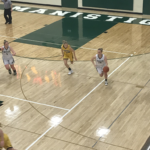 The Emeralds dribble the ball up the court in transition.