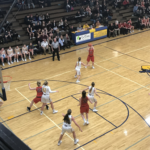 The Redettes look to feed the ball into the post in their 51-50 defeat of Negaunee.
