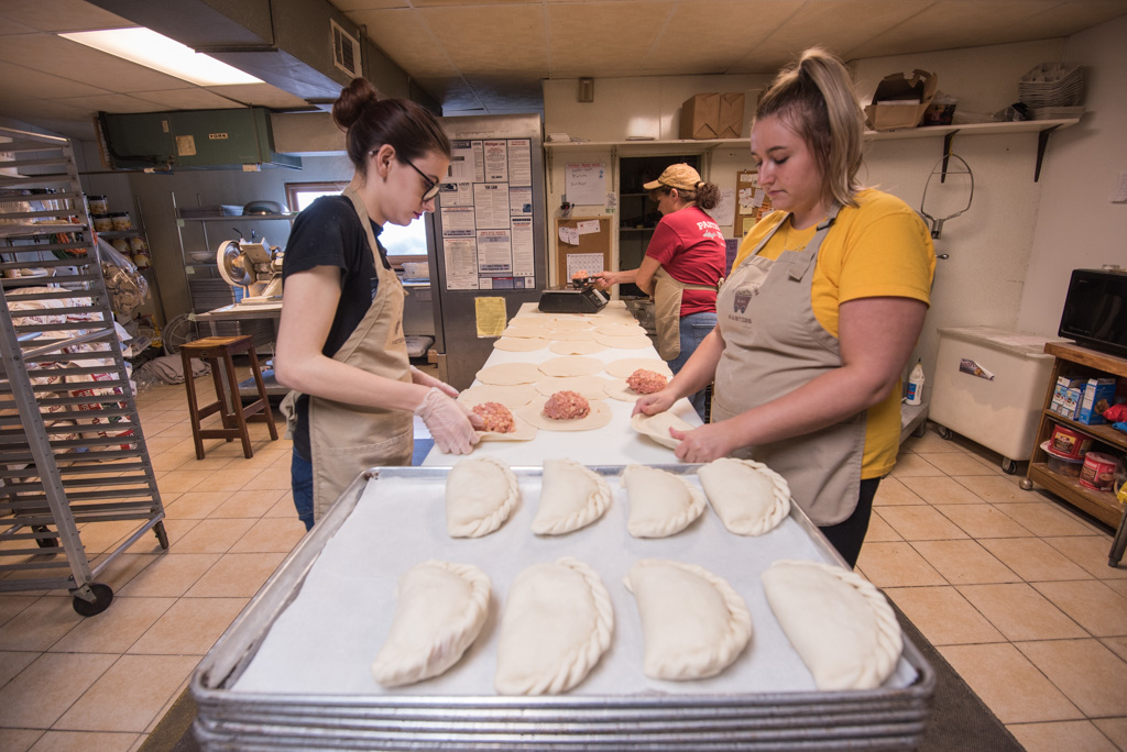 The girls working on crimping the edges of the pasties.