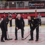 Fire Chief Ian Davis, Marquette City Manager Mike Angeli, and Marquette Police Officer Rob Hansen completing the ceremonial puck drop.
