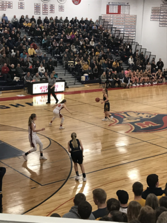 Negaunee crosses half-court in their 49-37 loss to the Westwood Patriots on 101.9 SunnyFM.