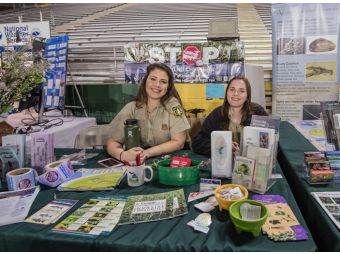 Holly Lipinski and Abby Petersen of the Hiawatha USFS Talk about Invasive Species at the 26th Annual UP Boat, Sport, and RV Show