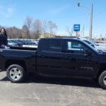 Brandee Korpi in the bed of a new Silverado