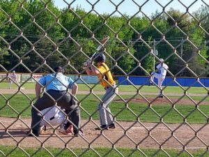 The Gladstone pitcher winds up to send the ball over home plate