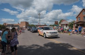 Hey that's us! We're in the Pioneer Days Parade each year as the voice of the Negaunee Miners!