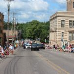 Police vehicles start off the 2019 Pioneer Days Parade