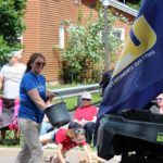Sara Cambensy hands out candy in the 2019 Pioneer Days parade