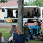 Lawn chairs gathered to listen to the Flat Broke Blues!