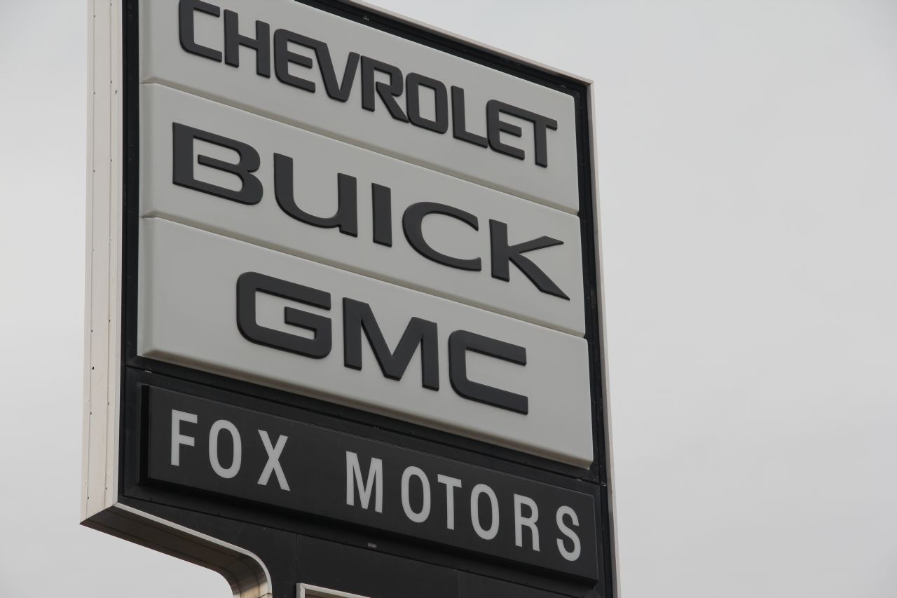 Dan DeVos About to Cut the Ribbon at Fox Chevy GMC Buick
