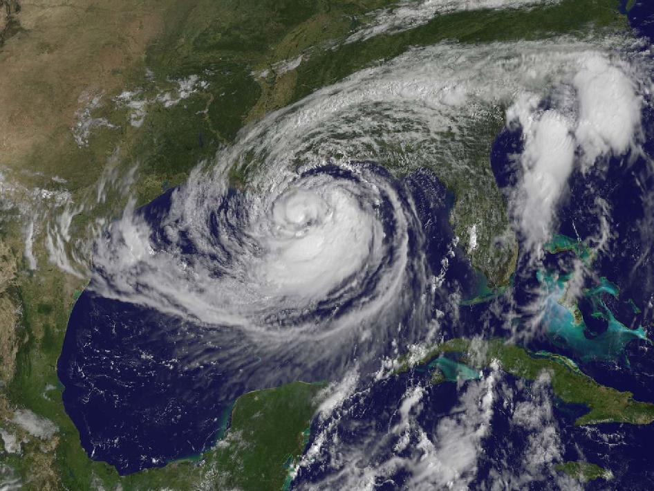 This visible image of Tropical Storm Isaac taken from NOAA's GOES-13 satellite shows the huge extent of the storm, where the eastern-most clouds lie over the Carolinas and the western-most clouds are brushing east Texas.
