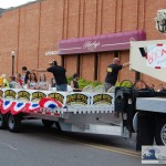 Midway Rentals and Sales in 4th of July Parade - Trowing Candy to the Children