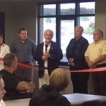 Lyn Swadley (builder) makes a speech following the Ribbon Cut in the new Marquette Township Community Room