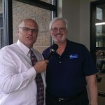 Todd Noordyk (left) with Mike Plourde (right) both of Great Lakes Radio, Inc. at the new Marquette Township Offices on Commerce Drive