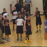Negaunee boys cheer on their friend Ryan before going to the locker room for half-time.