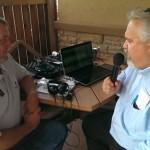 Walt interviews Greg Hildebrand at the 2014 Honor Credit Union Ribbon Cutting Negaunee Michiganc