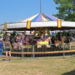 Riding the carousel at the Marquette County Fair