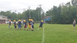 Returning starting quarterback Ryan Syrjala throwing a pass during Monday's practice.