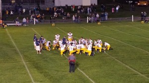 Coach Paul Jacobson addressing his team following the thrilling 31-22 victory vs. Calumet on Friday night