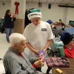 Bothwell middle schoolers hand out home made gifts after singing Christmas carols at the Jacobetti Home for Veterans