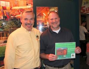 Joe Esbrook from Hiawatha Log Homes and Brian MacFalda - Winner of the Incredible Grand Prize