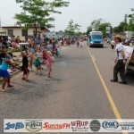Photo 13 - Dennis Helps Adam Throw Candy to Kids in Marquette July 4th Parade