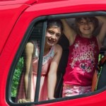 Girls in a Firetruck at Negaunee's Pioneer Days Parade, 2015