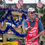 Tossing candy in the Pioneer Days Parade, Negaunee, MI 2015