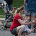 Mother and Daughter clapping as the Pioneer Days Parade goes by, Negaunee, MI 2015