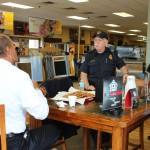 Lt. Thomas chats with Marquette Township Fire Chief Ron DeMarse