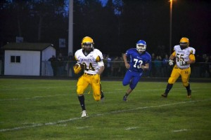 Varsity Football Player from Negaunee breaking away after a fantastic pass!
