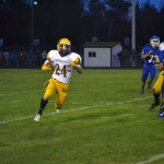 Negaunne Player gets some awesome time in with the ball here on the Ishpeming Football field