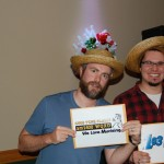 Finalist Nollan Pettersen and Garrett Green holding up their envelopes at theTwo Tickets to Paradise Giveaway