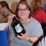 One of the door prize winners with her gift from Chocolay River Brewery in Harvey