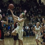 #32 going up to try to make a basket against Houghton