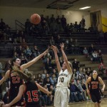 Miners Girls Varsity player putting it up for points!
