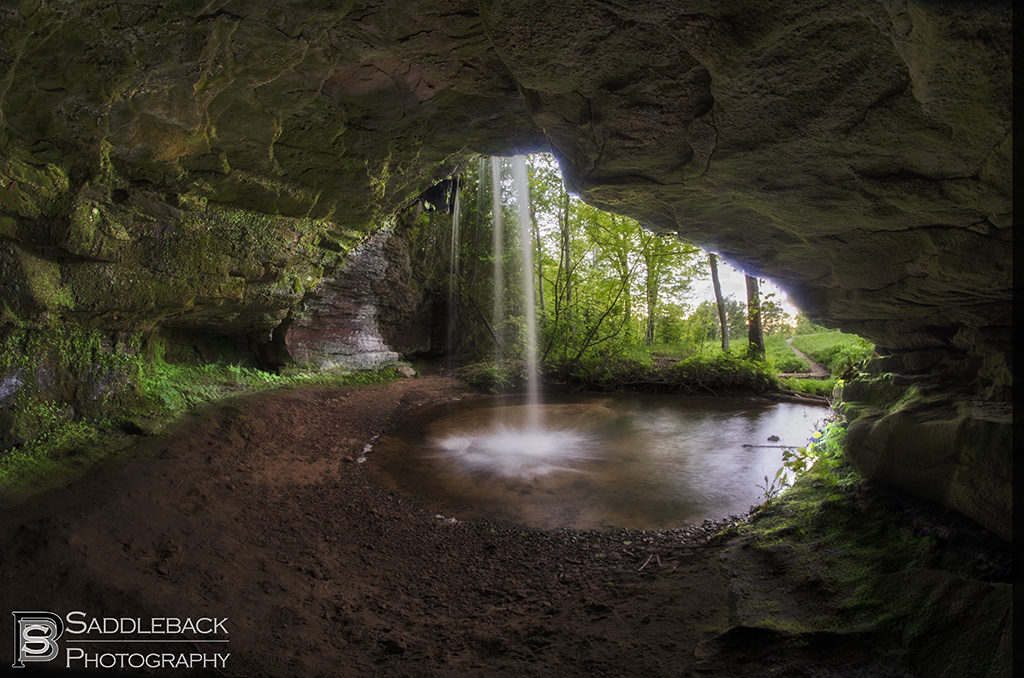 From inside the cave behind Scott Falls with the waterfall pouring overhead.