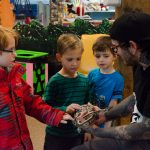 These little boys found the ball python to be really cool!