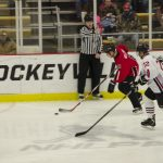 Heat breaks away with the puck