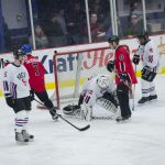 The Pigs' Goalie blocking a shot on goal.