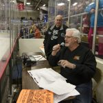 Sunny.FM's Mike the ring announcer for tonight's game reading off the winning Chuck-A-Puck number.