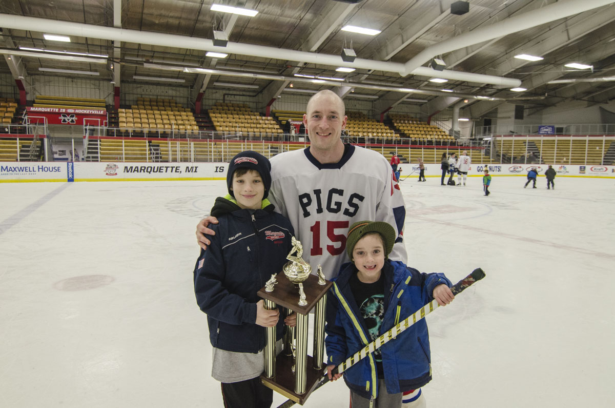 #15 - Adam Maynard from the Pigs with this two sons and the trophy.