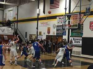 The Negaunee Miners Boys Basketball team won 67-37 over the Ishpeming Hematites and our the District Champions. GO MINERS!!