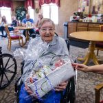 Ruth was so happy to receive the third and final door prize.