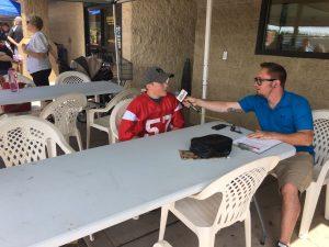 Ryan interviewing player, Ashton Demboski.