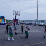 Kids enjoying basketball.