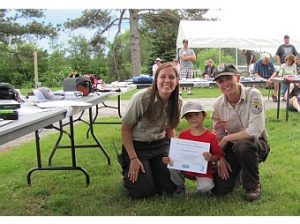 Alaina and Sara with Garrett Larsen, 5, Who Caught a 13.5 Inch Pike Featured Image