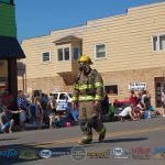 Fireman in protective gear for entire parade route