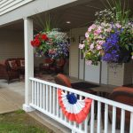Woodland maintains a gorgeous entry way with hanging baskets and gardens.