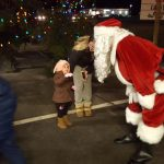 Santa saying hello to one of the little girls in the crowd.